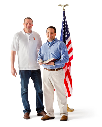 two men in front of American Flag